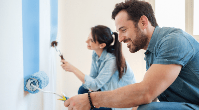 Couple painting and renovating their home