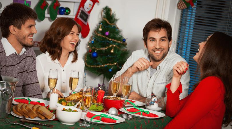 Four friends enjoying Christmas dinner