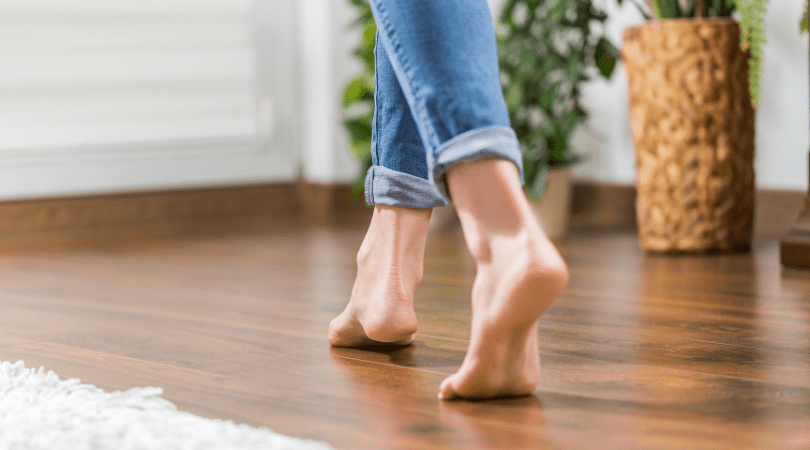walking on wooden flooring